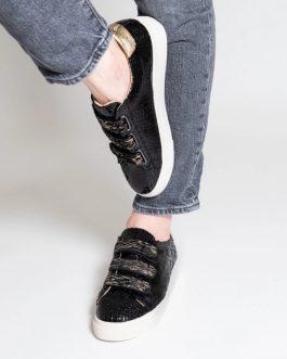 Baskets noires effet craquelés à scratchs zèbre